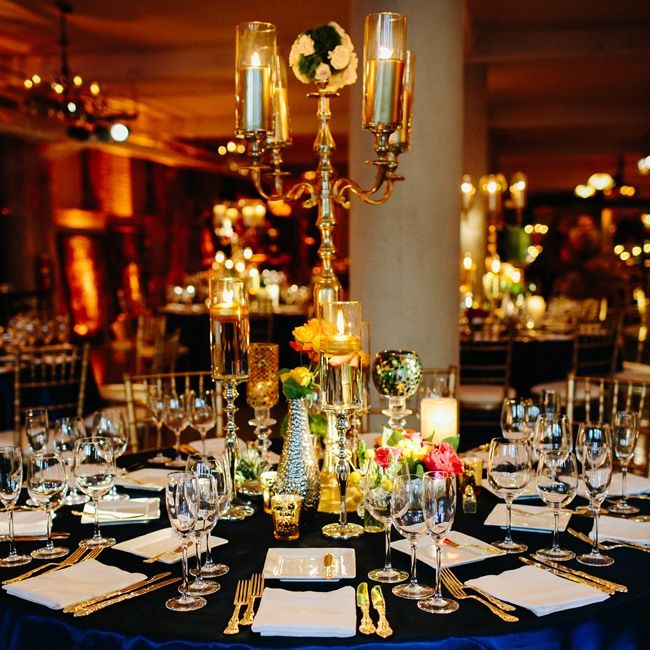 Gold flatware, vintage candelabras, petite floral arrangements and navy linens topped the