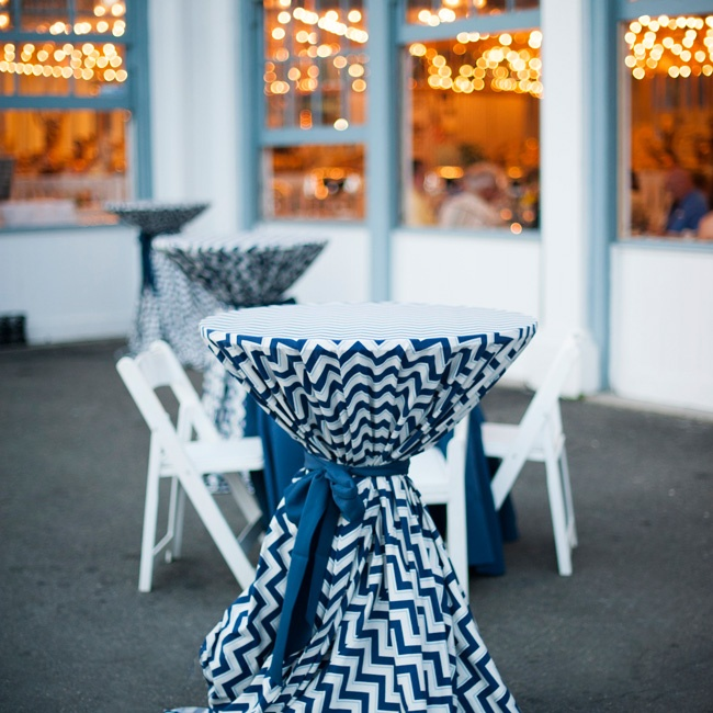 Geometric-patterned linens covered the tall tables at the cocktail hour.