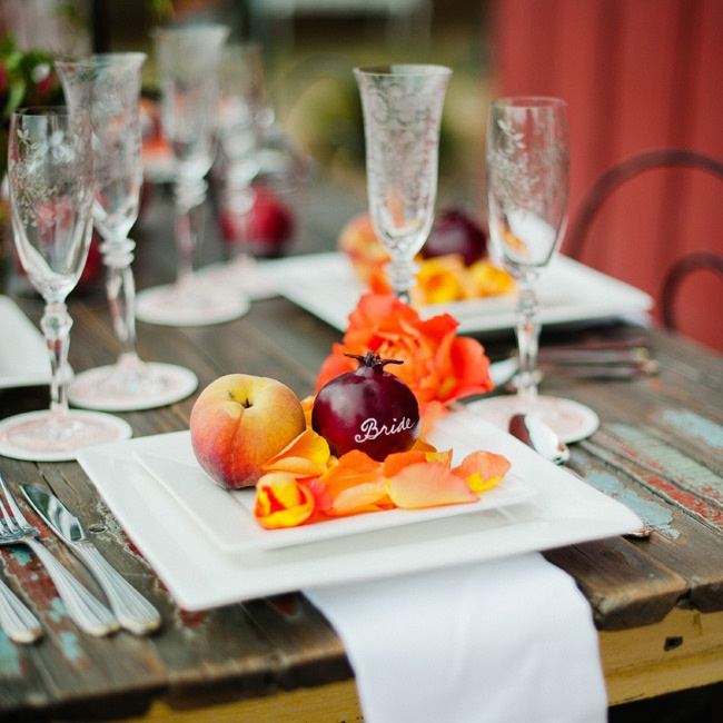 Pomegranates, which signify prosperity and abundance in many cultures, mixed with sweet peaches create and ideal color palette for a fall wedding. The hard outer shell of pomegranates makes them a perfect canvas for calligraphy: Write guests' names in white pen and use the fruit in lieu of place cards. Rose petals in a peach hue soften the presenta ...