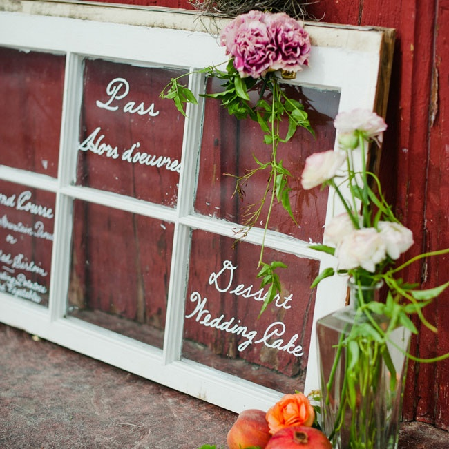 Menu boards are a more casual way of conveying the day's gastronomy to your guests. A whimsical stand-in for a chalkboard, a divided glass door with each course written in it's own panel looks charming and vintage. Leaning the glass on a colorful wall adds vibrancy to the display.