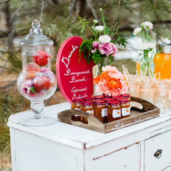 "Carry the fruit them through to the very end of the wedding by sending guests home with jars of tasty peach preserves. Handwritten labels with touching sentiments like ""spread the love"" make for a memorable favor."