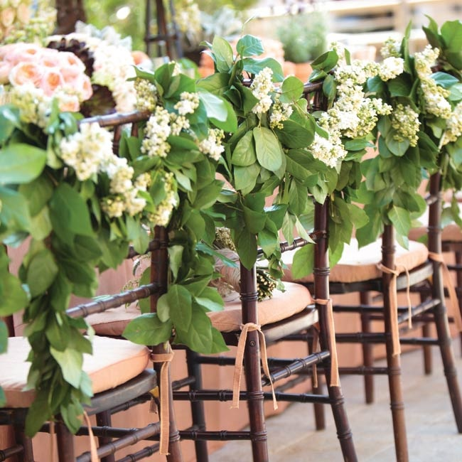 Chairs are often neglected when it comes to decor. But why? After all, they're the part of our day your guests will be most intimate with! Lemon Leaves and white lilac carry the garden theme to new, interactive heights.