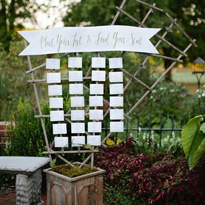 "Let's face it: Old is the new new. Here, a weathered old trellis is reborn as a seating chart. ""Plant"" it in a bed of moss for a garden-worthy touch."