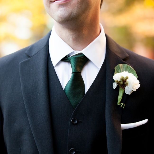 Katie and Craig opted for dashing three-piece charcoal suits instead of tuxedos for the guys, which they felt were more practical. Each groomsman was gifted a pair of cuff links with a map of his hometown on one and his college town on the other.