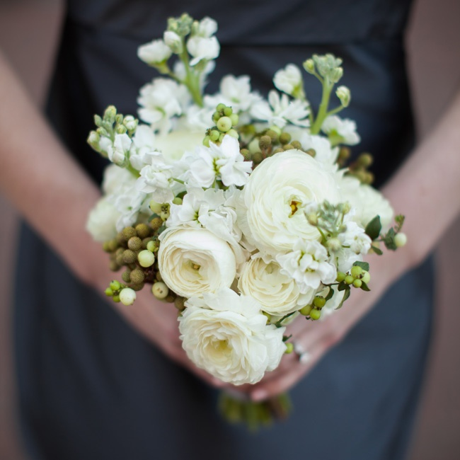 """I wanted a soft and textured look that wasn't just plain white roses but also wasn't crazy,"" Katie says of the florals."