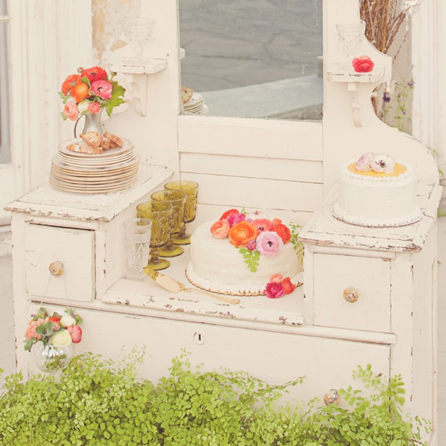 Travel back to a time when people made do with what they had--even if it meant using bedroom furniture for a dessert bar.  Repurpose once-loved pieces, like this charming antique vanity, for a quintessentially vintage day.