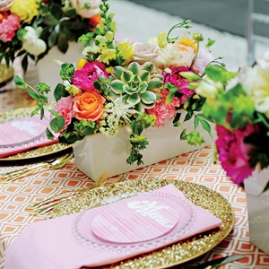 Dress down gold flatware and crystal-encrusted chargers for a daytime event by placing them on tablecloths in bright, bold hues. Floral arrangements that feature unexpected combinations, like architectural succulents, spiky tuberoses and lush carnations and roses, also tone down the look. Event production and floral design throughout by Rhiannon Ba ...