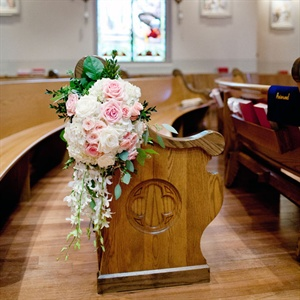 Blush and White Rose Pew Arrangements
