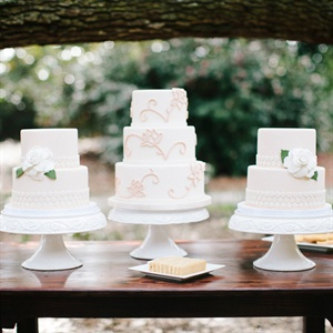 Having multiple cakes can add some depth to an otherwise mundane dessert table. Keep the look interesting by varying the design on the sweet treats. While the two side cakes are decorated with a honeycomb design inspired by the vases, the middle one mimics the linen instead. Cakes by One Belle Bakery in Wilmington; cake stands by Pressed Cotton