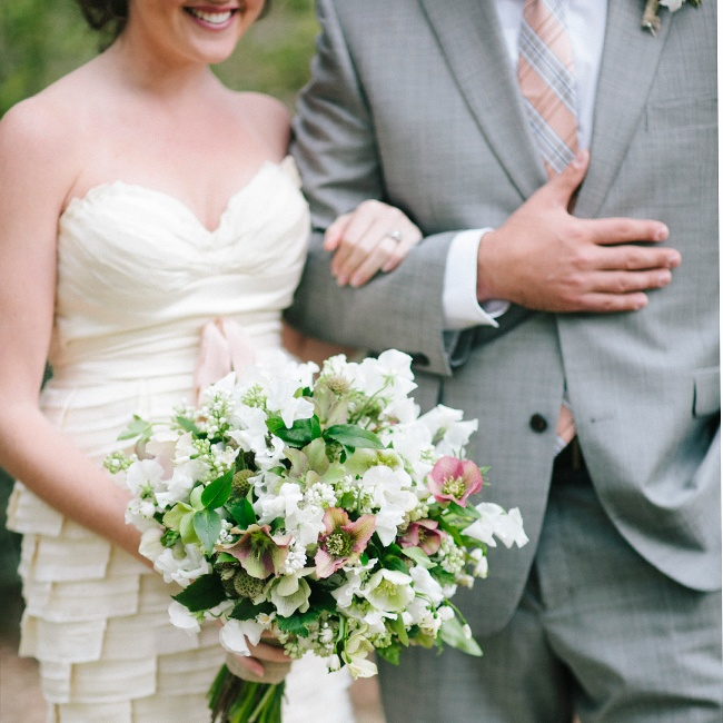 For a spin on the typical bridal bouquet, use more than flowers. By including lots of greenery, you not only add unexpected color and texture, you end up with a cheery product that has a just-picked look. Floral design by Salt Harbor Designs; dress by Joynoelle in Minneapolis