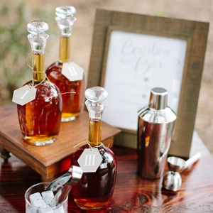 For a truly Southern touch, set up a tasting table with a few types of Bourbon, which originated in the South, instead of serving a signature cocktail. Be sure to include the correct accoutrements, such as decanters and specialty glassware. Decanters by Pressed Cotton in Wilmington