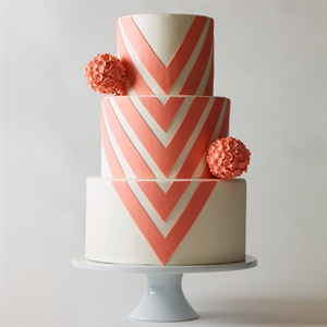 It's all about the stripe, and a clever twist on the popular pattern instantly feels even more contemporary. Focus on chevron's fine angular point to add an exclamation mark to the special occasion. Pretty pomanders, in a chic shade such as coral, soften the effect.