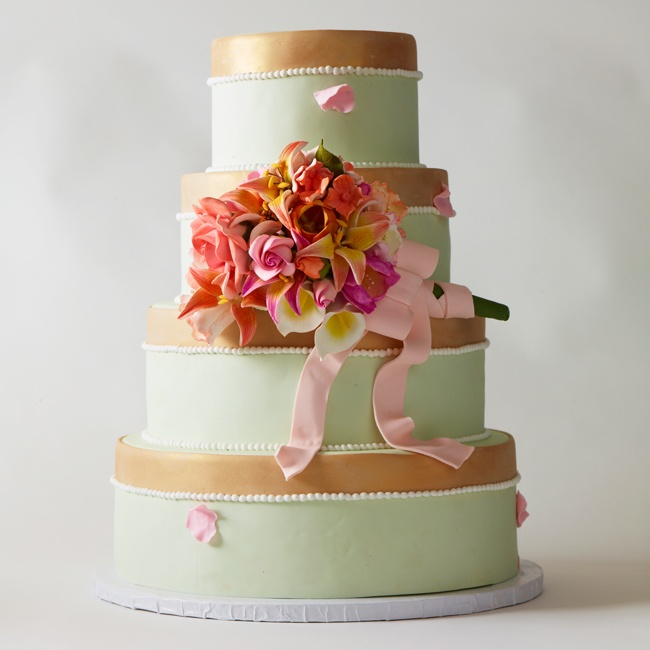 A reception in a garden, barn or backyard calls for a cake with bucolic beauty. Deliciously soft mint sets the stage for an eye-catching bouquet of garden flowers tied with ribbon that feels freshly picked. (Tip: Let it mimic the blooms you'll carry down the aisle!)