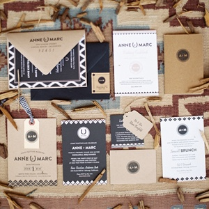 Anne designed their black, white and kraft paper stationery suite herself, mixing patterns and materials for a cohesive look.