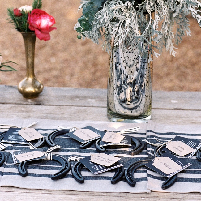 Table assignments tied to lucky horseshoes doubled as favors -- a fitting touch for their rustic locale.
