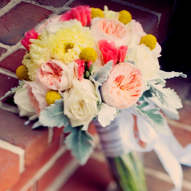 Racquel carried a bouquet of peach garden roses, yellow craspedia,