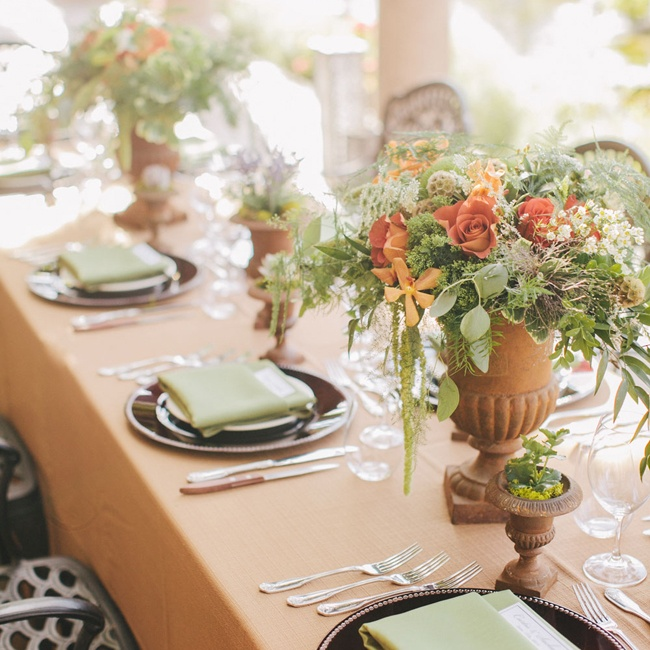 The centerpieces featured peach blooms and tons of greenery.