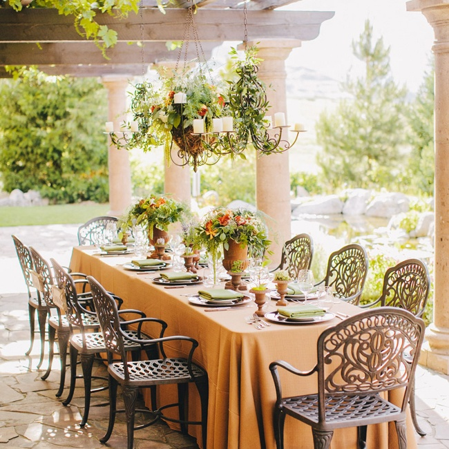 The couple chose a green and orange color palette for their chic outdoor Tuscan-style reception.