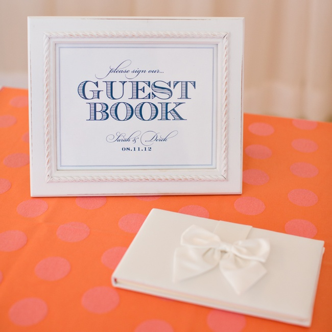 The couple chose a simple white guestbook for their guests to write their well-wishes and advice.