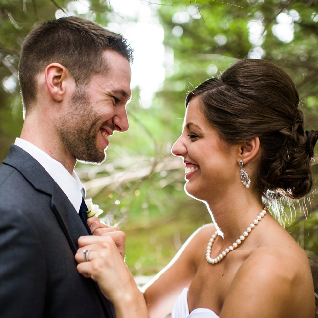The bride wore an elegant updo and accessorized with traditional pearls.