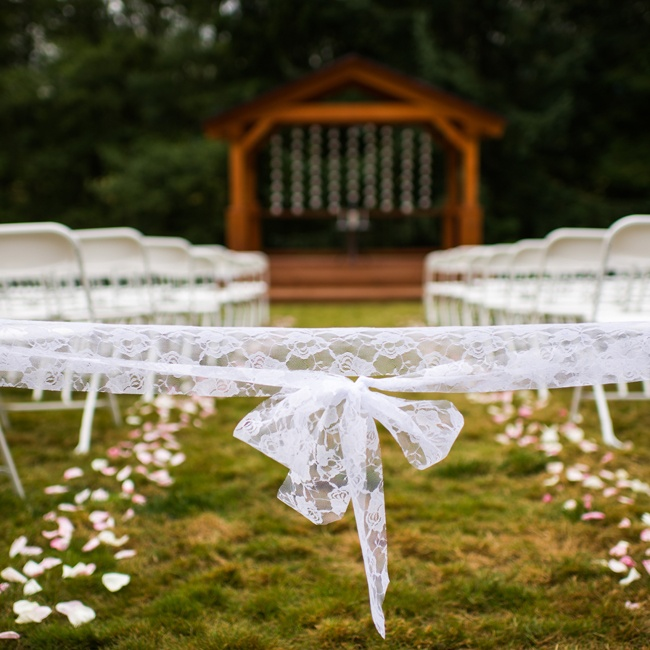 A lace ribbon marks the ceremony entrance.