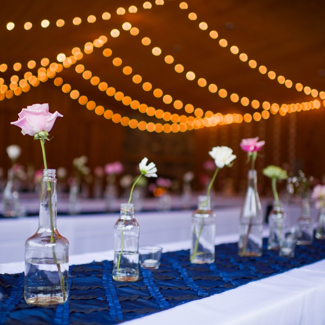 The couple used minimalist, single-flower centerpieces.