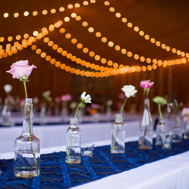 The couple used minimalist, single-flower centerpieces.