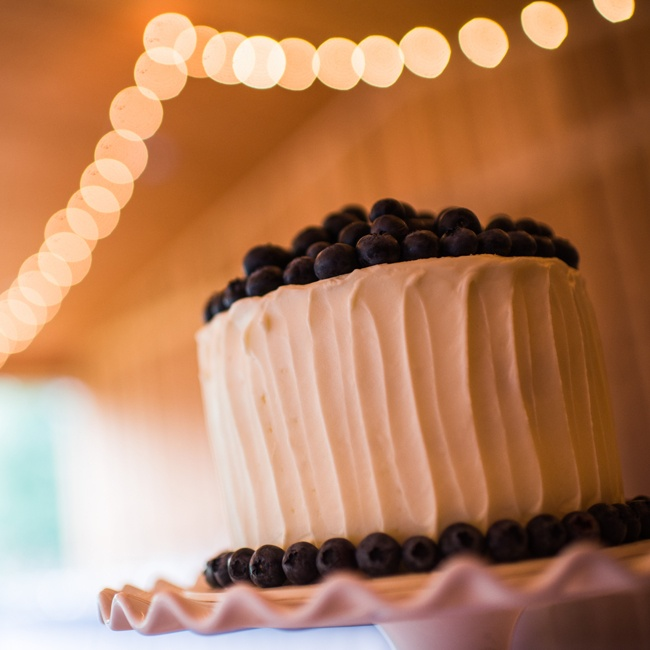 The couple's buttercream frosted wedding cake was garnished with fresh blueberries.