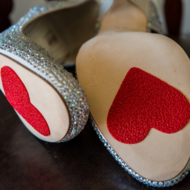 These cute crystal shoes have adorable red hearts on the soles.