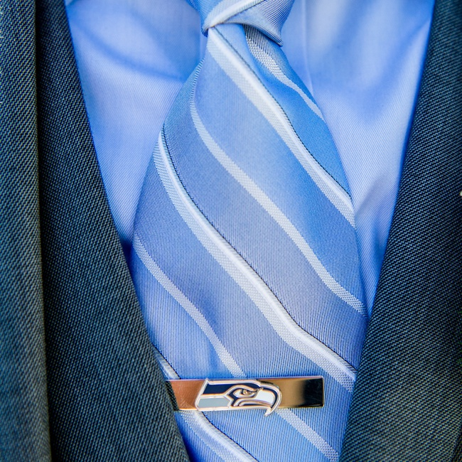 As a Seahawks fan, the groom accessorized with a sports-themed tie bar.