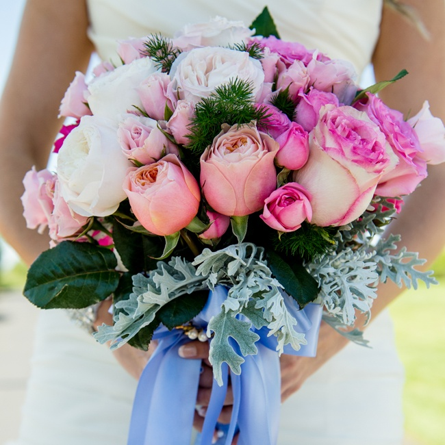 The bride carried a very feminine bouquet of pink roses.