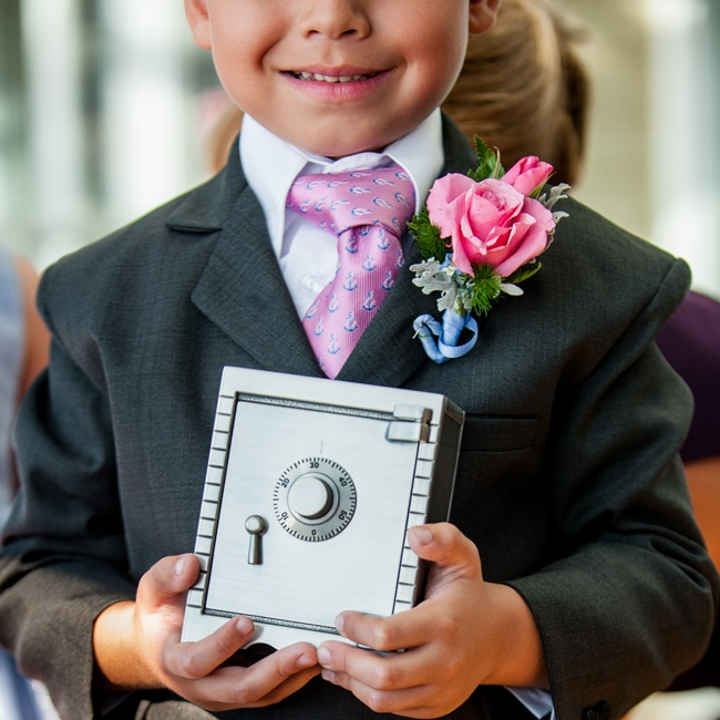 The ringbearer kept the rings secure by walking them down the aisle in a safe.