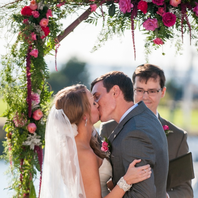 The couple shared a first kiss with their wedding arch as the beautiful backdrop.