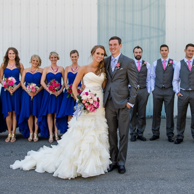 Sarah's bridesmaids wore royal blue dresses which coordinated with the groomsmen's blue formalwear accessorized with pink ties and boutonnieres.