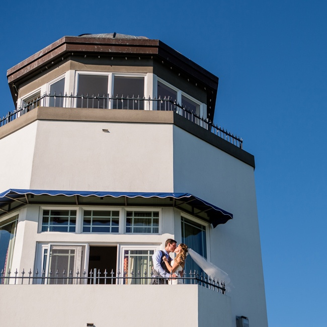 After the ceremony, the couple posed for a cute intimate photo together on the tower balcony.