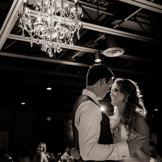 The couple shared their first dance under the hanging chandelier at their reception.