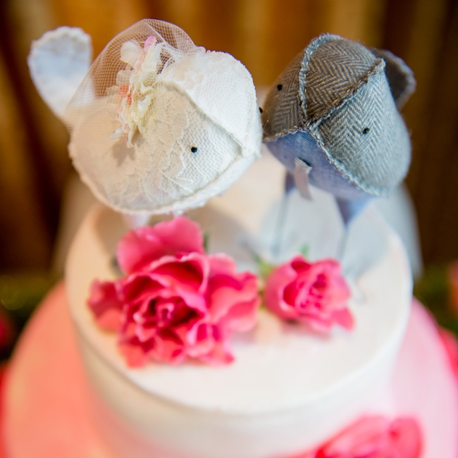 Two love birds topped the couple's pink and white cake.