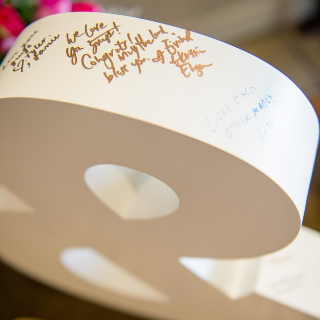 The couple got crafty with a large ampersand guest book for their friends and family to sign.