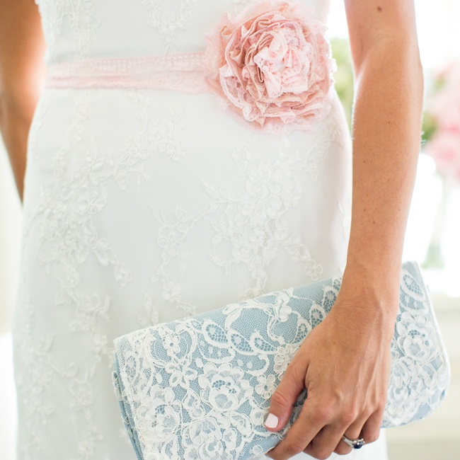 Christina accessorized with a lacy floral sash and clutch in soft pastel colors.