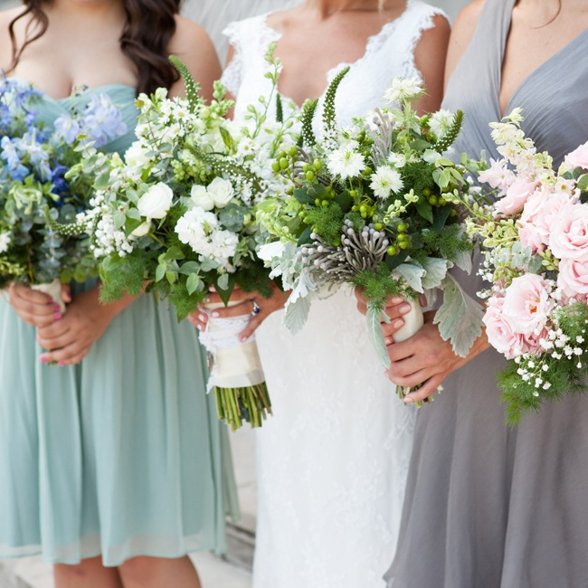 Christina and her brides maids carried lush vintage-inspired bouquets. Each bouquet was filled with eucalyptus leaves, springeri, snapdragons and a mix of blooms in a blue, white or pink color palette.