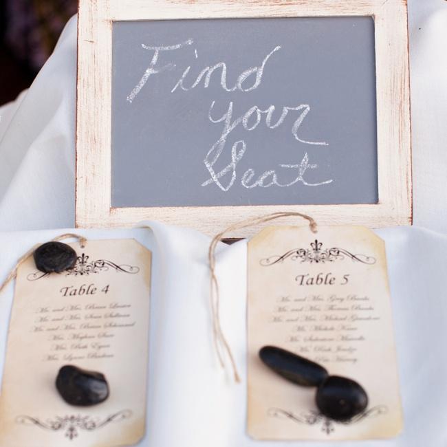 Christina and Michael used antiqued gift tags as escort cards for a rustic vintage-inspired flair.