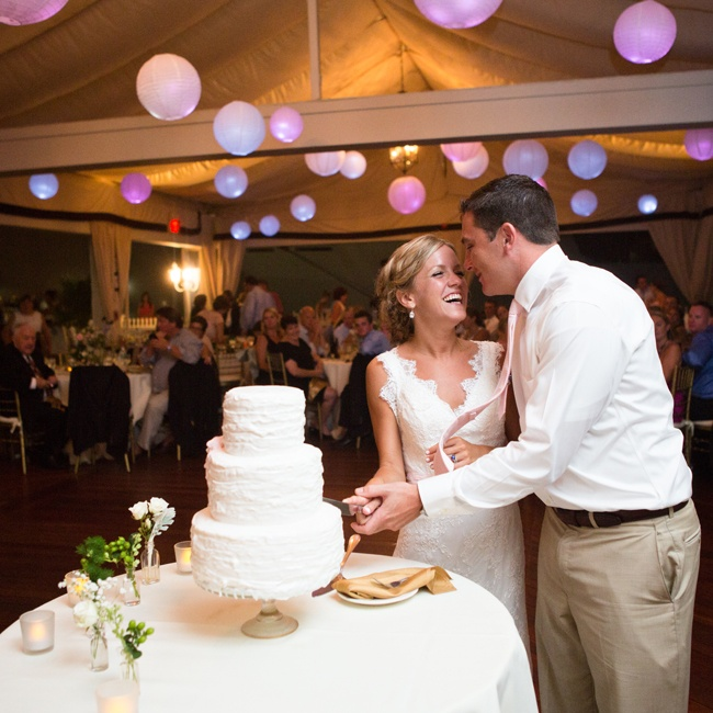 The couple chose a simple white three-tiered cake with a combed detail from Newport Cakes.