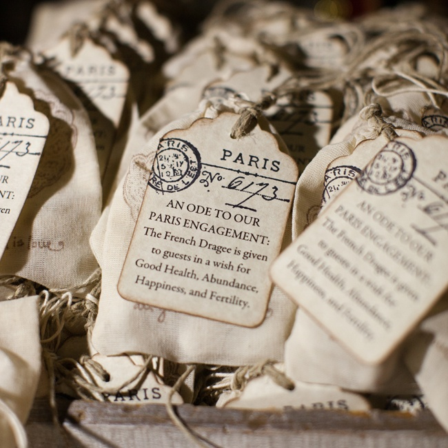 "In honor of their Parisian engagement, Christina and Michael gave guests French dragees in small muslin bags, which are typically given to guests ""in a wish for Good Health, Abundance, Happiness and Fertility."""