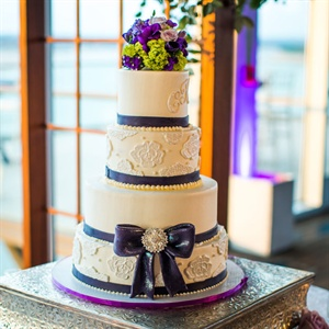 Wedding Cake with Purple and Lace Accents