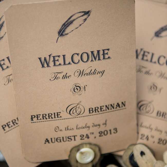 The couple opted to DIY their wedding ceremony programs on paper fans.