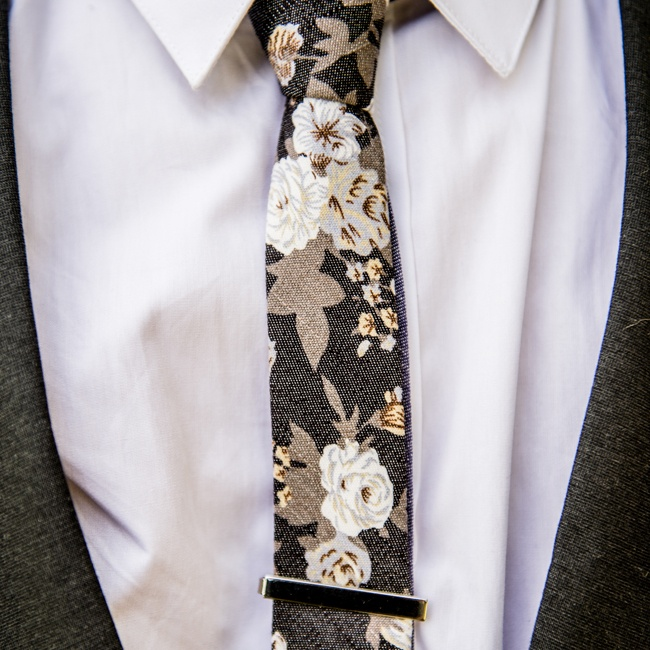 The groom wore a skinny tie in a floral pattern.