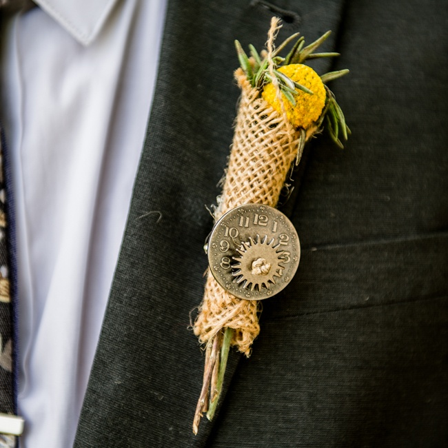 The groomsmen's boutonnieres were made of burlap and billy balls which made for a personalized rustic touch.