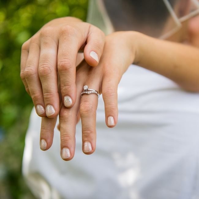 The bride showed off her glittery manicure and wedding band.