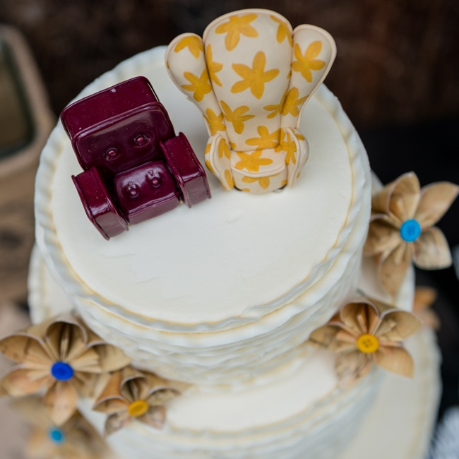 These creative cake toppers added personality to the couple's cake.