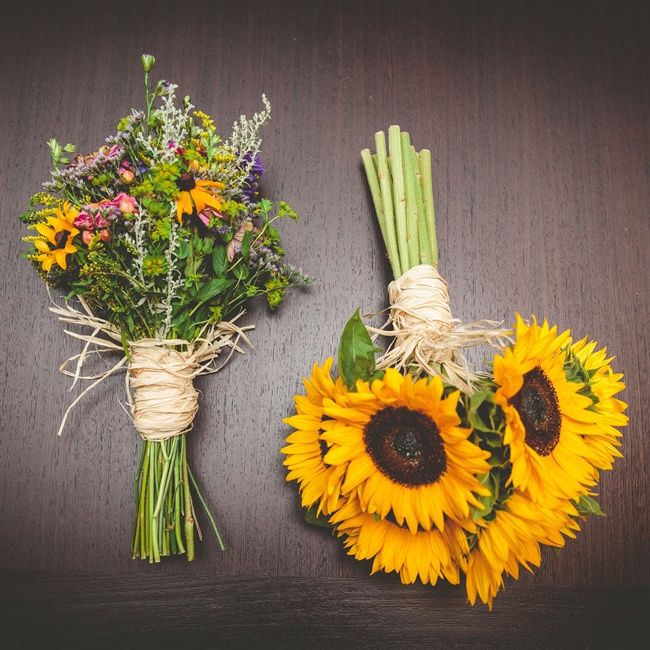 Marilyn and her bridesmaids carried yellow bouquets of sunflowers, black-eyed Susans and other wildflowers wrapped in raffia.